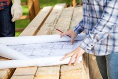 Architect With Blueprint At Site Stock Images