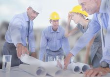 Architect with blueprints on building site Stock Images