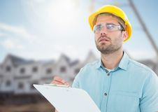 Architect with blueprints on building site Royalty Free Stock Photo