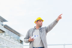 Architect with blueprints pointing towards sky Royalty Free Stock Images