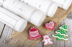 Architect blueprints project and  christmas gingerbread Stock Images