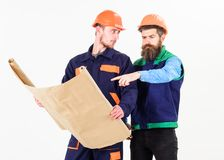 Architect and build concept. Men in helmets with blueprint. On white background. Architects in hard hat on busy faces discuss drawing, plan, project. Builder Royalty Free Stock Photo