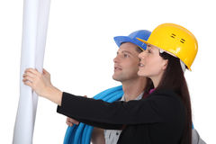 Architect and builder. Looking at plans Stock Image