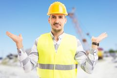 Architect or builder holding copyspace on construction site. With arms and palms up and empty space on the sky Royalty Free Stock Photos