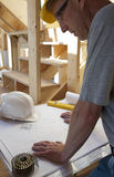 Architect or builder looking at blueprints Stock Photography