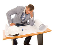 Architect or builder studying a blueprint Stock Image