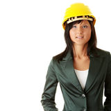 Architect or builder wearing a yellow hart hat Royalty Free Stock Images
