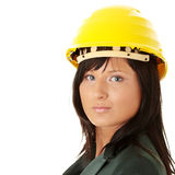 Architect or builder wearing a yellow hart hat Royalty Free Stock Photography