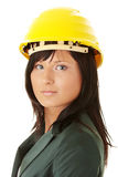 Architect or builder wearing a yellow hart hat Stock Photo