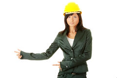 Architect or builder wearing a yellow hart hat Royalty Free Stock Image