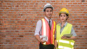 Architect builder  and woman engineer Stock Photos