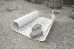 Architect building plans open on a building site. Architechtural building plans open on a construction site Stock Image