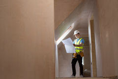 Architect On Building Site Looking At House Plans Royalty Free Stock Photos