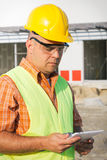 Architect On Building Site Using Digital Tablet Royalty Free Stock Photos