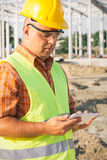 Architect On Building Site Using Digital Tablet Royalty Free Stock Photo