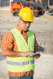 Architect On Building Site Using Digital Tablet Royalty Free Stock Photography