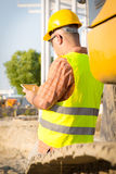 Architect On Building Site Using Digital Tablet Royalty Free Stock Image