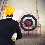 Architect builds a business target . Mixed media Stock Images