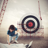 Architect builds a business target . Mixed media Royalty Free Stock Images