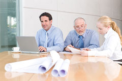 Architect business group meeting. Looking at notes Royalty Free Stock Photo