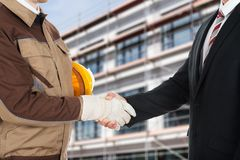 Architect and businessman shaking hands Royalty Free Stock Photos