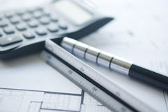 Architect with calculator and plan, pencil and ruler Royalty Free Stock Photography