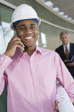 Architect On A Call With Blueprint Stock Photography