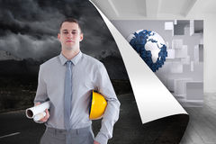 Architect carrying construction plans and helm Royalty Free Stock Photos