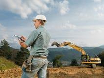 Architect checking construction progress Stock Photography