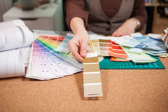 Architect choosing from different colors on the cards. In front of her. Architecture and construction. Color pallete Royalty Free Stock Image