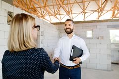Architect and civil engineer at the construction site. Stock Photo