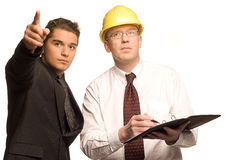 Architect and client. The architect an the inspector isolated (copyspace royalty free stock images