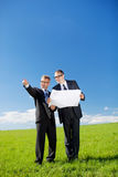 Architect and client discussing a blueprint Royalty Free Stock Photo