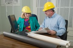 Architect And Client Looking At Blueprints 10 Stock Photos