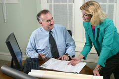 Architect And Client Looking At Blueprints 3 Stock Photography
