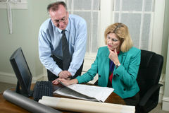 Architect And Client Looking At Blueprints 4 Stock Photos