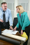 Architect And Client Looking At Blueprints 7 Stock Photo