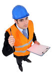 An architect with a clipboard. Royalty Free Stock Images