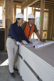 Architect And Co-Worker In Construction Site Royalty Free Stock Photos