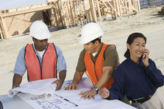 Architect And Co-Workers At Construction Site Stock Photography