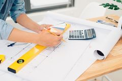 Architect concept, Architects office working with blueprints.  stock images