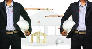 Architect and construction crane lifting home and safety helmet Royalty Free Stock Photos