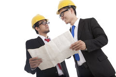 Architect and construction engineer discussing 1. Architect and construction engineer or surveyor discussion plans and blueprints Stock Image