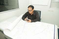Architect and construction engineer discussing plan in office. Stock Image