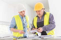 Architect and construction engineer indoor meeting. Stock Images