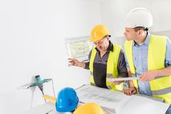 Architect and construction engineer indoor meeting. Royalty Free Stock Photo