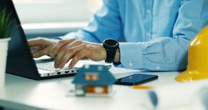 Architect construction engineer working with laptop in office stock video