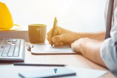 Architect construction engineer working with sketch pen tablet i. N office making a construction project in CAD software, selective focus Royalty Free Stock Photos