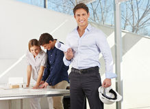 Architect with construction plan Stock Photo