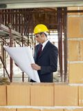 Architect in construction site Royalty Free Stock Image